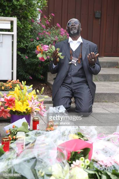 Dembo Kvubally from The Gambia prays in front of the residence of former German Chancellor Helmut Kohl in Oggersheim Germany 17 June 2017 He says he...