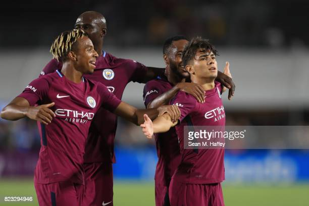 Demeaco Duhaney Eliaquim Mangala and Raheem Sterling congratulate Brahim Diaz of Manchester City after he scored a goal during the second half of the...