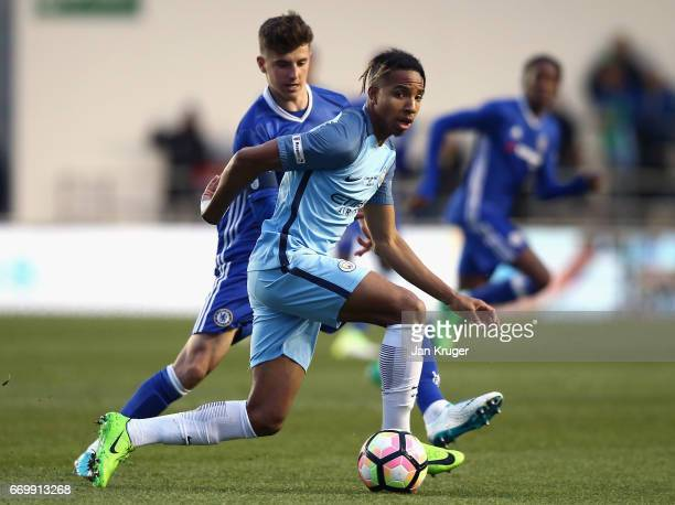 Demeaco Duhaney of Manchester City is put under pressure from Mason Mount of Chelsea during the FA Youth Cup Final First Leg match between Manchester...