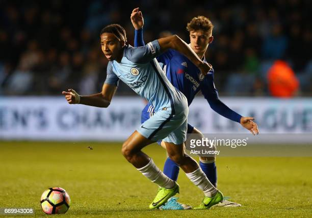 Demeaco Duhaney of Manchester City takes the ball past Mason Mount of Chelsea during the FA Youth Cup Final First Leg match between Manchester City...