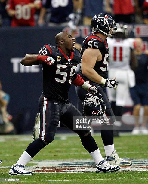 DeMeco Ryans of the Houston Texans celebrates after the Houston Texans defeated the Atlanta Falcons at Reliant Stadium on December 4 2011 in Houston...
