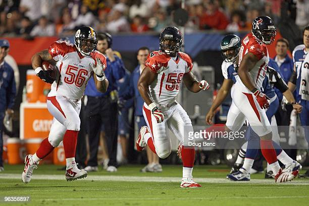 DeMeco Ryans of the Houston Texans covers LaMarr Woodley of the Pittsburgh Steelers after making an interception during the 2010 AFCNFC Pro Bowl at...