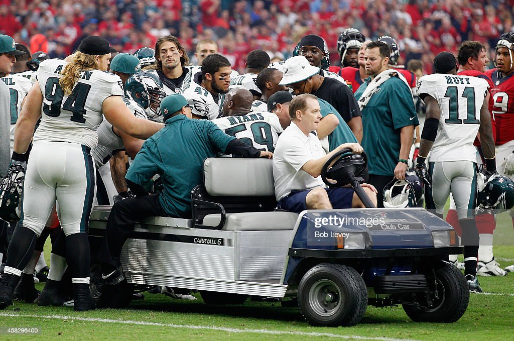 DeMeco Ryans #59 of the Philadelphia Eagles is helped off the field after suffering an injury against the Houston Texans at Reliant Stadium on November 2, 2014 in Houston, Texas.