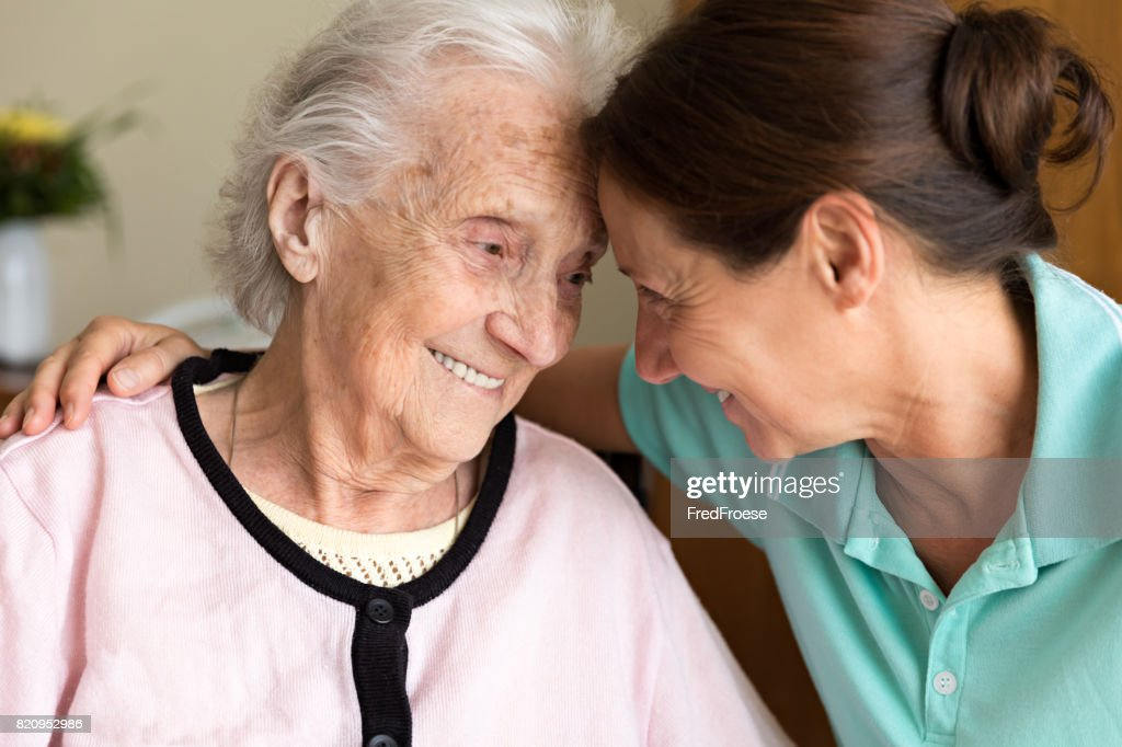 Dementia and Occupational Therapy - Home caregiver and senior adult woman : Stock Photo