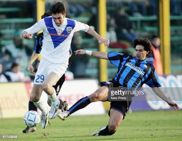 Demetreo Albertini of Atalanta slides into a tackle against Andreo Caracciolo of Brescia during the Serie A match between Atalanta and Brescia on...