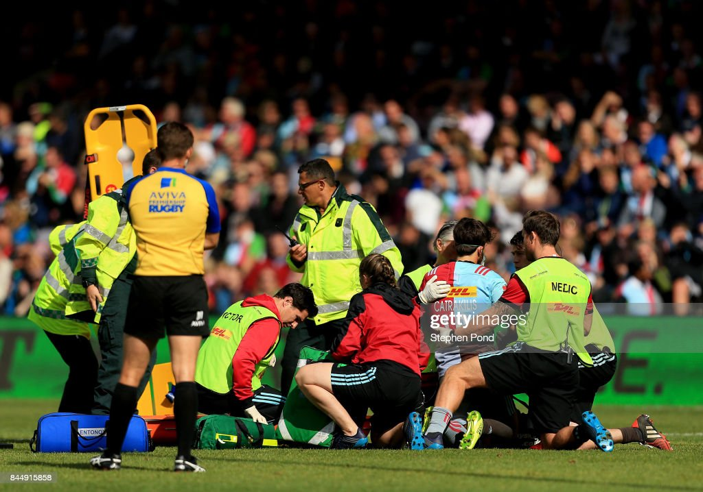 Demetri Catrakilis of Harlequins is treated before leaving the field injured during the Aviva Premiership match between Harlequins and Gloucester Rugby at Twickenham Stoop on September 9, 2017 in London, England.