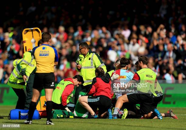 Demetri Catrakilis of Harlequins is treated before leaving the field injured during the Aviva Premiership match between Harlequins and Gloucester...