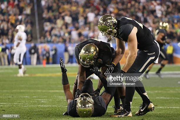Demetri Goodson of the Baylor Bears celebrates with teammates after his second quarter interception against the UCF Knights during the Tostitos...
