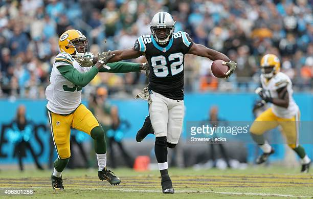 Demetri Goodson of the Green Bay Packers tries to tackle Jerricho Cotchery of the Carolina Panthers during their game at Bank of America Stadium on...
