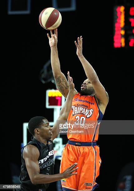 Demetri McCamey of the Taipans shoots over Kerron Johnson of the Breakers during the round 23 NBL match between the New Zealand Breakers and the...