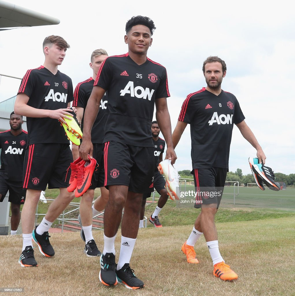 Demetri Mitchell and Juan Mata of Manchester United walk out ahead of a first team training session at Aon Training Complex on July 11, 2018 in Manchester, England.
