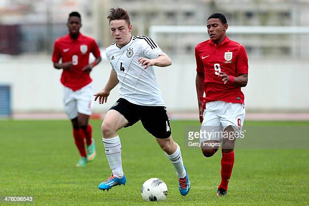 Demetri Mitchell of England challenges Niclas Bahn of Germany during the Under17 Algarve Cup between U17 England and U17 Germany at Lagos sport...