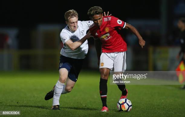 Demetri Mitchell of Manchester United and Oliver Skipp of Tottenham during the Premier League 2 match between Tottenham Hotspur and Manchester United...