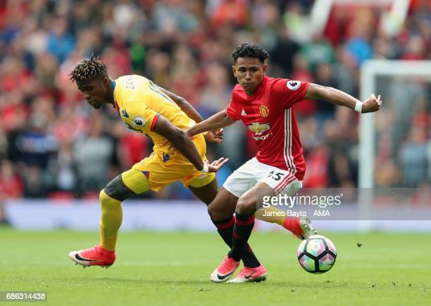 Demetri Mitchell of Manchester United and Wilfried Zaha of Crystal Palace during the Premier League match between Manchester United and Crystal...
