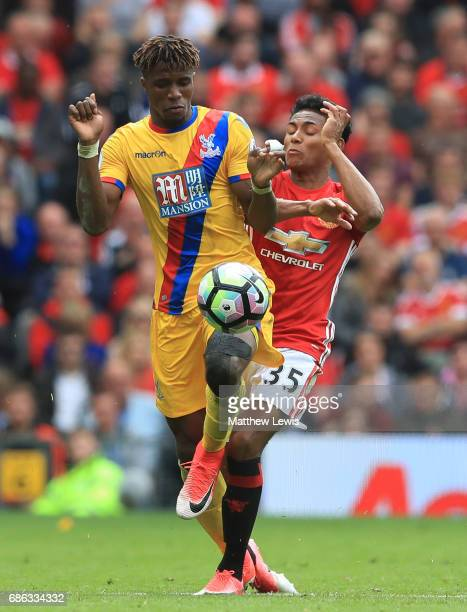 Demetri Mitchell of Manchester United and Wilfried Zaha of Crystal Palace in action during the Premier League match between Manchester United and...