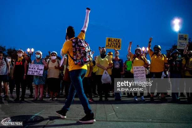 Demetria Hester leads the Moms United for Black Lives Matter group as they begin their march to the Mark O. Hatfield Federal Courthouse and the...