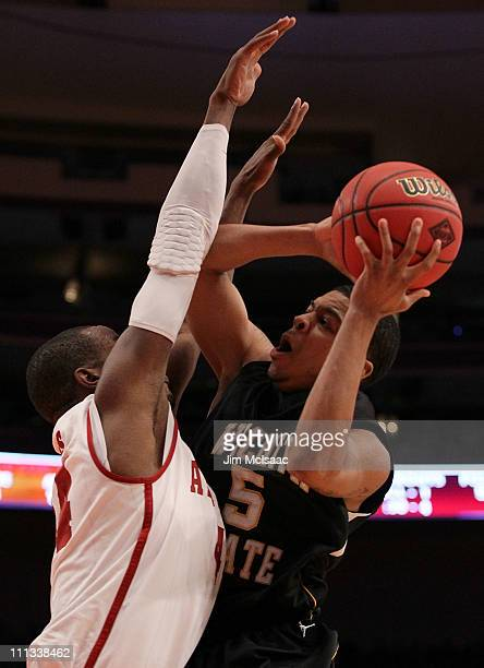 Demetric William of the Wichita State Shockers goes to the hoop against Chris Hines of the Alabama Crimson Tide during the 2011 NIT Championship game...