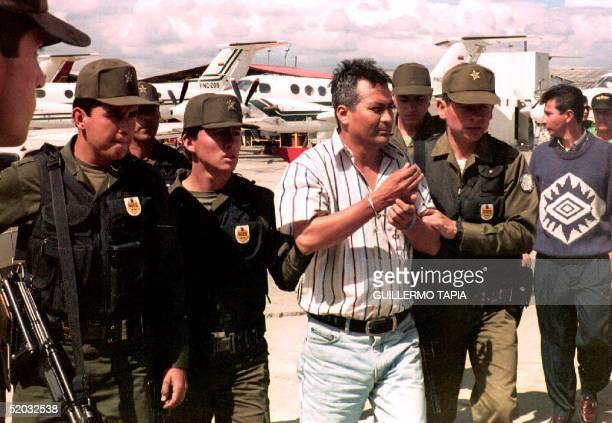 Demetrio Limaniel Chavez Pena is led away by police moments after he was brought to Bogota and hours after he was captured by the Colombian secret...