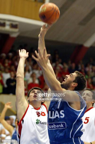 Demetrios Ntikoudis from Greece goes up for two points next to Mirsad Turkcan from Turkey during their match in group D of the FIBA European...