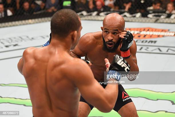 Demetrious Johnson and John Dodson face off in their flyweight championship bout during the UFC 191 event inside MGM Grand Garden Arena on September...
