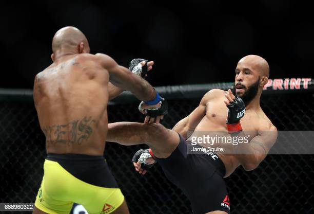 Demetrious Johnson battles Wilson Reis during their Flyweight Championship bout on UFC Fight Night at the Sprint Center on April 15 2017 in Kansas...