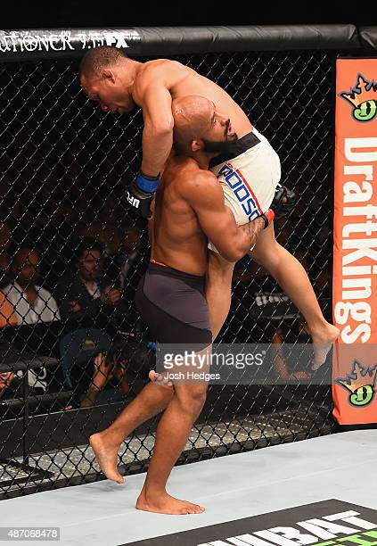 Demetrious Johnson carries John Dodson in their flyweight championship bout during the UFC 191 event inside MGM Grand Garden Arena on September 5...