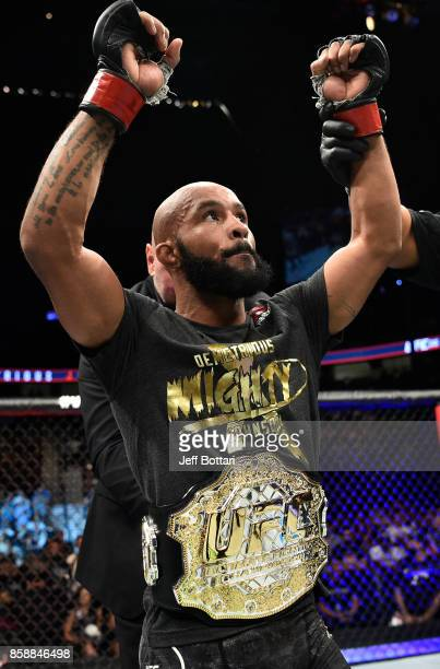 Demetrious Johnson celebrates after his submission victory over Ray Borg in their UFC flyweight championship bout during the UFC 216 event inside...