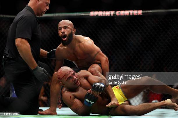 Demetrious Johnson celebrates as he defeats Wilson Reis to win their Flyweight Championship bout on UFC Fight Night at the Sprint Center on April 15...