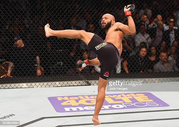 Demetrious Johnson celebrates his TKO victory over Henry Cejudo in their flyweight championship bout during the UFC 197 event inside MGM Grand Garden...