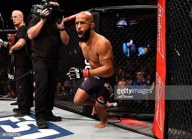 Demetrious Johnson enters the Octagon before his flyweight championship bout against Timothy Elliott during The Ultimate Fighter Finale event inside...