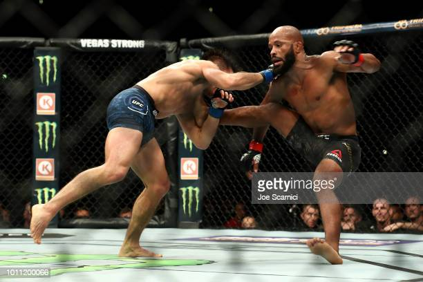 Demetrious Johnson is taken to the ground by Henry Cejudo in the fourth round of the UFC Flyweight Title Bout during UFC 227 at Staples Center on...