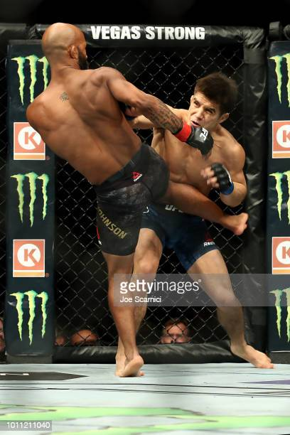 Demetrious Johnson kicks Henry Cejudo in the first round of the UFC Flyweight Title Bout during UFC 227 at Staples Center on August 4 2018 in Los...