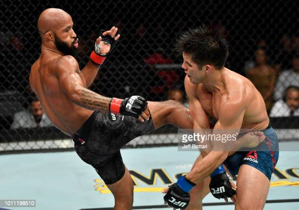 Demetrious Johnson kicks Henry Cejudo in their UFC flyweight championship fight during the UFC 227 event inside Staples Center on August 4 2018 in...