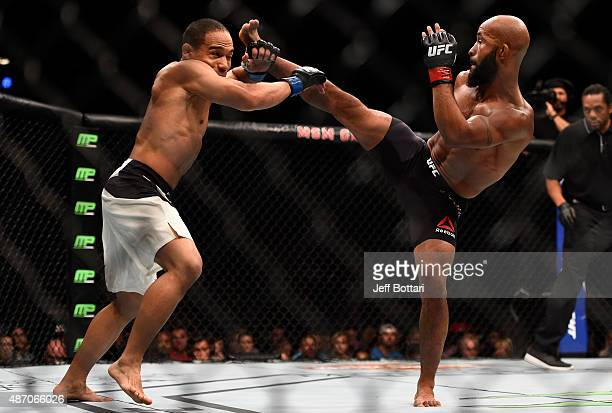 Demetrious Johnson kicks John Dodson in their flyweight championship bout during the UFC 191 event inside MGM Grand Garden Arena on September 5 2015...