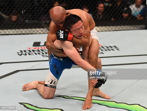 Demetrious Johnson of the United States attempts a rear choke submission against Kyoji Horiguchi of Japan in their UFC flyweight championship bout...