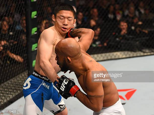 Demetrious Johnson of the United States punches Kyoji Horiguchi of Japan in their UFC flyweight championship bout during the UFC 186 event at the...