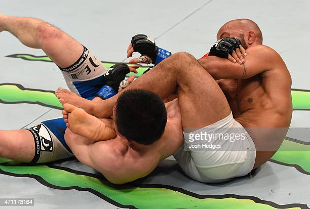 Demetrious Johnson of the United States secures an arm bar submission against Kyoji Horiguchi in their UFC flyweight championship bout during the UFC...