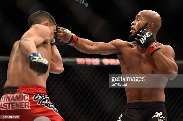 Demetrious Johnson punches Chris Cariaso in their flyweight bout during the UFC 178 event on September 27 2014 in Las Vegas Nevada