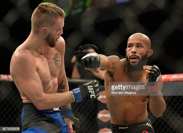 Demetrious Johnson punches Timothy Elliott in their flyweight championship bout during The Ultimate Fighter Finale event inside the Pearl concert...