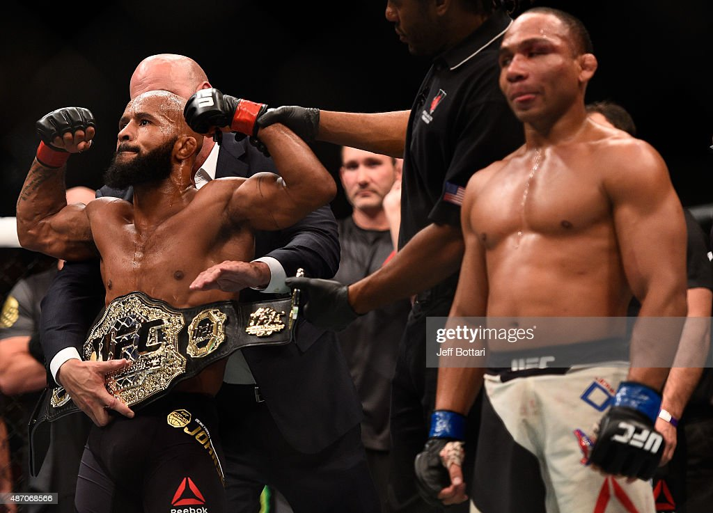 Demetrious Johnson (left) reacts to his victory over John Dodson (right) in their flyweight championship bout during the UFC 191 event inside MGM Grand Garden Arena on September 5, 2015 in Las Vegas, Nevada.