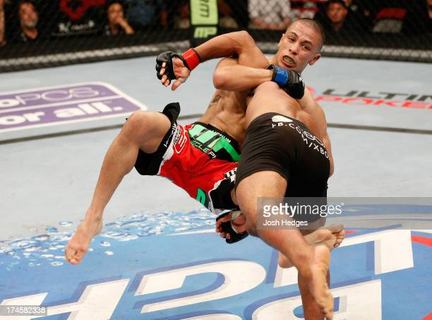 Demetrious Johnson slams John Moraga in their flyweight championship bout during the UFC on FOX event at Key Arena on July 27, 2013 in Seattle,...
