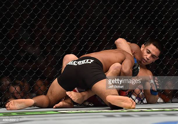 Demetrious Johnson takes down Chris Cariaso in their flyweight bout during the UFC 178 event on September 27 2014 in Las Vegas Nevada