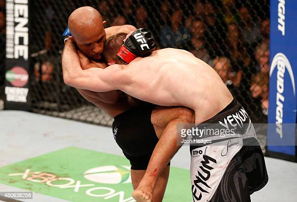 Demetrious Mighty Mouse Johnson knees Ali Bagautinov in their UFC flyweight championship bout at Rogers Arena on June 14 2014 in Vancouver Canada