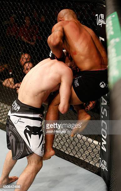 Demetrious Mighty Mouse Johnson lands a jumping knee against Ali Bagautinov in their UFC flyweight championship bout at Rogers Arena on June 14 2014...