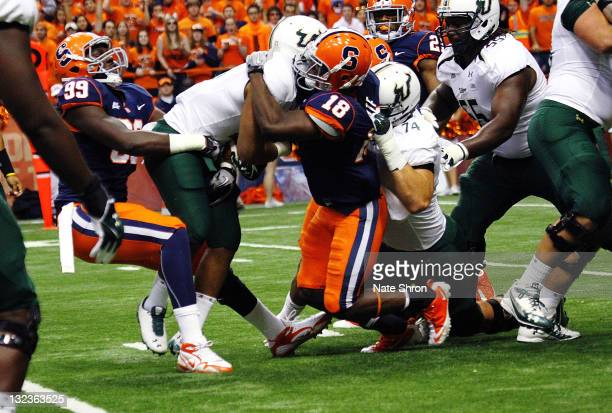 Demetris Murray of the South Florida Bulls is tackled by Chandler Jones and Siriki Diabate of the Syracuse Orange during the game at the Carrier Dome...