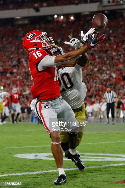 Demetris Robertson of the Georgia Bulldogs can't make a third quarter touchdown catch against Shaun Crawford of the Notre Dame Fighting Irish at...