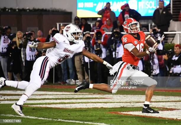 Demetris Robertson of the Georgia Bulldogs is unable to make the catch of a third quarter pass against Lee Moses of the Massachusetts Minutemen on...