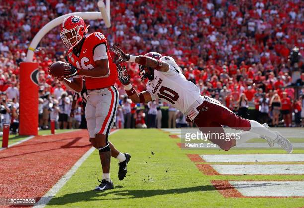 Demetris Robertson of the Georgia Bulldogs pulls in this touchdown reception against R.J. Roderick of the South Carolina Gamecocks in the second half...