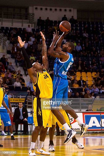 Demetrius Alexander #16 of BC Azovmash competes with Anthony Tucker #24 of Aris BSA 2003 during the Eurocup Basketball Date 1 game between Aris BSA...