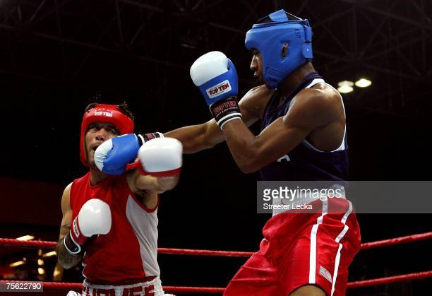Demetrius Andrade of the USA lands a punch on Diego Chaves of Mexico in the boxing semifinals during the XV Pan American Games at Riocentro on July...